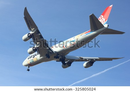 NOVOSIBIRSK - OCT 10: Boeing 747-8 Cargolux at Novosibirsk Airport. Cargolux celebrates 45 years of flying with a CUTAWAY logo jet on newly-delivered Boeing . October 10, 2015 in Novosibirsk Russia - stock photo