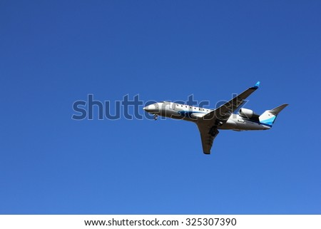 NOVOSIBIRSK - OCT. 08: Bombardier CRJ-200 of Yamal airlines at Novosibirsk Tolmachevo Airport. CRJ200 are family regional airliners manufactured by Bombardier. October 08, 2015 in Novosibirsk Russia - stock photo