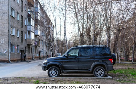 """Novosibirsk, Russia - 16 April 2016: The car """"UAZ Patriot"""" stands in the Parking lot of an apartment house in Novosibirsk from April 16, 2016. - stock photo"""