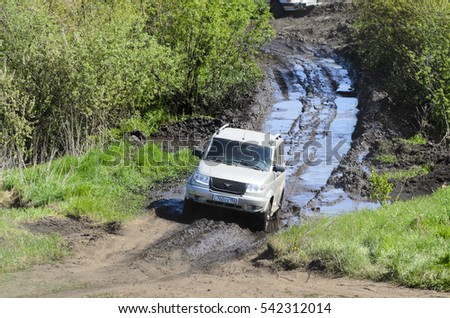 Novosibirsk, Russia - August 03, 2016: Unknown people in off-road vehicles in the summer in the field in Novosibirsk 03 Aug 2016.