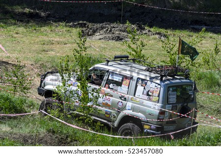 "Novosibirsk, Russia-5 June 2016: Russian offroad vehicle ""UAZ Patriot"" the competition runs track in a field near a forest in Novosibirsk on June 5, 2016."