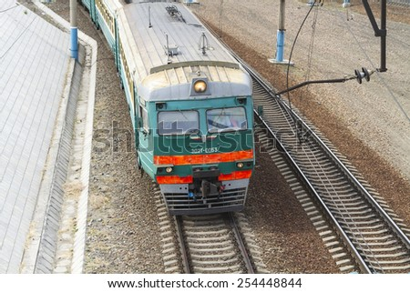 NOVOSIBIRSK, RUSSIA - JUNE 28: Suburban train near the train station platform on June 28, 2014 in Novosibirsk. - stock photo