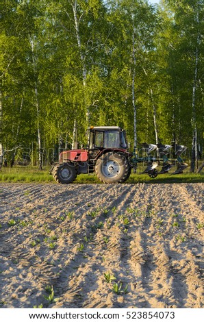 Novosibirsk, Russia - June 20, 2016, the Tractor Belarus 92P is on the rest of the field in Novosibirsk on 20 June 2016.