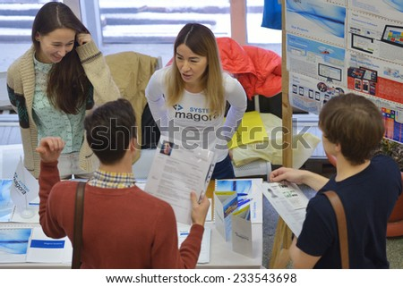 NOVOSIBIRSK, RUSSIA - NOVEMBER 14, 2014: Students of Novosibirsk state university getting information about jobs. The job fair was organized by the NSU Center of graduates - stock photo
