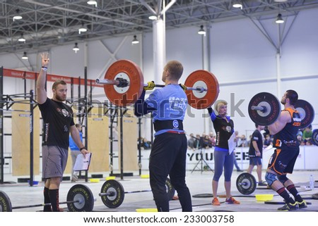 NOVOSIBIRSK, RUSSIA - NOVEMBER 16, 2014: Unidentified athletes during the International crossfit competition Siberian Showdown. The competition included in the program of the festival Siberian Health. - stock photo
