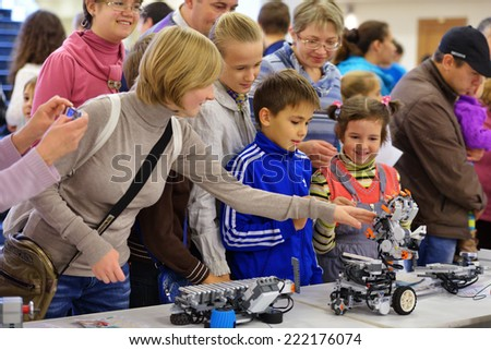 NOVOSIBIRSK, RUSSIA - OCTOBER 5, 2014: Toothy plastic robot demonstrated for children on the 4th Russian Science Festival. The event aimed to popularize science and demonstrate technical advances - stock photo