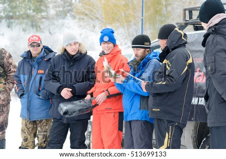 Novosibirsk, Russia - October 20, 2016: unidentified people, fishermen spinning, the jury awarded the prize to the lucky winner and he considers in Novosibirsk on 20 October 2016.