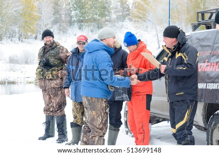 Novosibirsk, Russia - October 20, 2016: unidentified people, fishermen spinning, the jury awarded the prize to the lucky winner shaking hands in Novosibirsk on 20 October 2016.