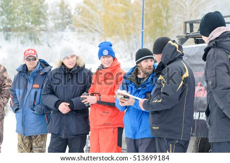 Novosibirsk, Russia - October 20, 2016: unidentified people, the fishermen on the jury of spinning gives prize to lucky winner cunning in Novosibirsk on 20 October 2016.