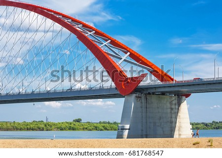Novosibirsk, Siberia, Russia - July 17, 2017: view of the Ob river, beach and Bugrinskij bridge connecting the Kirovsky and Oktyabrsky districts of Novosibirsk
