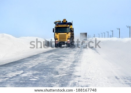 NOVYY URENGOY, RUSSIA - APRIL 12, 2014: Interurban road of the Russian Far North at spring.