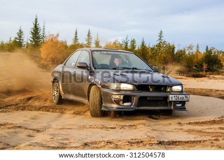 NOVYY URENGOY, RUSSIA - AUGUST 30, 2015: Motor car Subaru Impreza at the countryside.