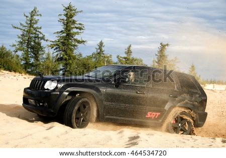 NOVYY URENGOY, RUSSIA - AUGUST 6, 2016: Off-road car Jeep Grand Cherokee SRT-8 at the countryside.