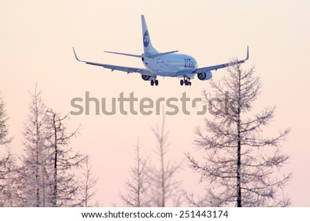 NOVYY URENGOY, RUSSIA - FEBRUARY 8, 2014: UTair Boeing 737 arrives to the Novyy Urengoy International airport.
