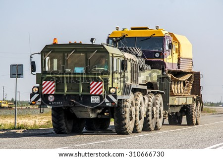 NOVYY URENGOY, RUSSIA - JULY 17, 2013: Green KZKT-7428 Rusich heavy semi-trailer truck at the city street. - stock photo