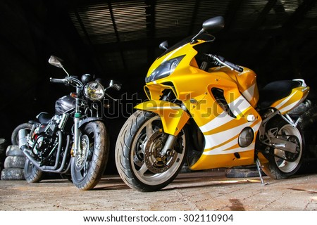 NOVYY URENGOY, RUSSIA - JULY 6, 2014: Sport motorcycle Honda CBR600RR in the dark garage. - stock photo