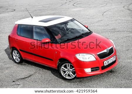NOVYY URENGOY, RUSSIA - MAY 13, 2016: Bright red compact hatchback car Skoda Fabia in the city street. - stock photo