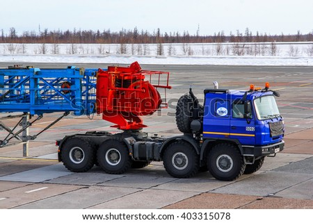 NOVYY URENGOY, RUSSIA - MAY 6, 2014: Heavy duty semi-trailer truck Tatra TerrNo1 carries a heavy industrial construction in the city street. - stock photo
