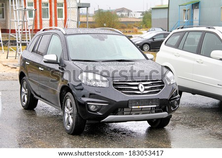 NOVYY URENGOY, RUSSIA - SEPTEMBER 1, 2013: French motor car Renault Koleos exhibited at the annual open air motor show Autosalon.