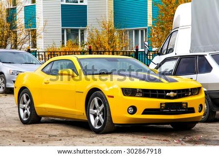 NOVYY URENGOY, RUSSIA - SEPTEMBER 9, 2012: Motor car Chevrolet Camaro at the city street. - stock photo