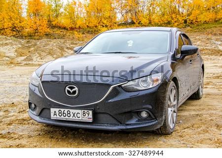 NOVYY URENGOY, RUSSIA - SEPTEMBER 13, 2014: Motor car Mazda 6 at the countryside. - stock photo
