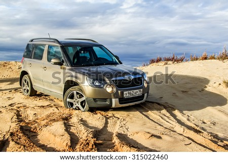 NOVYY URENGOY, RUSSIA - SEPTEMBER 5, 2015: Motor car Skoda Yeti at the sand desert. - stock photo