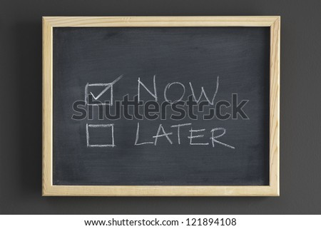 Now and later check boxes written on a blackboard