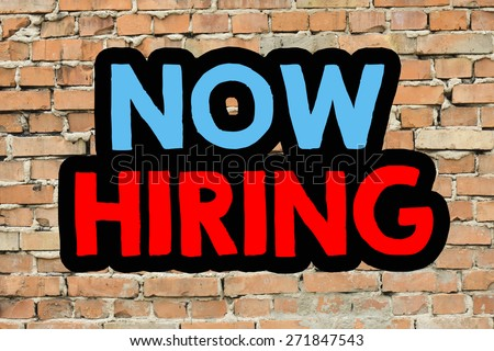 Now hiring On brick wall background