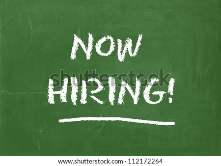 Now hiring, written on blackboard. Open position sign. - stock photo