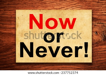 Now or never! Motivational concept - stock photo