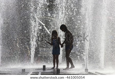NOWY SACZ, POLAND - JULY 30,2016: Kids playing in the fountain during the heat in Nowy Sacz, Poland.