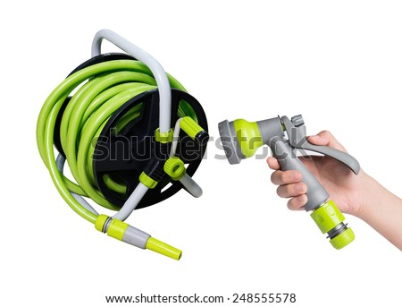 Nozzle of a garden water hose isolated on white background with the hose blurred in the background  - stock photo