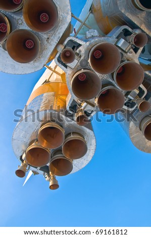 Nozzles space rocket Soyuz. Close-up on a background of clear blue sky.