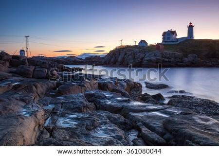 Nubble Lighthouse at sunrise, Cape Neddick, Maine, USA - stock photo