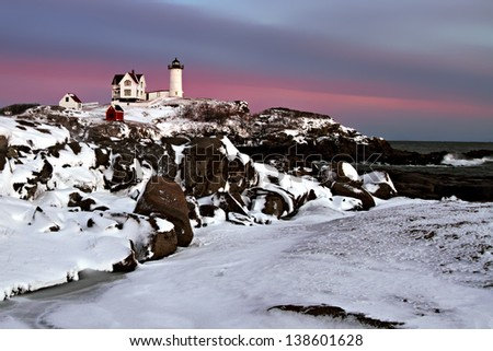 Nubble Lighthouse in Winter with Snow, Cape Neddick, York Maine - stock photo