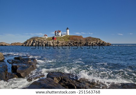 Nubble Lighthouse on a beautiful clear day - stock photo