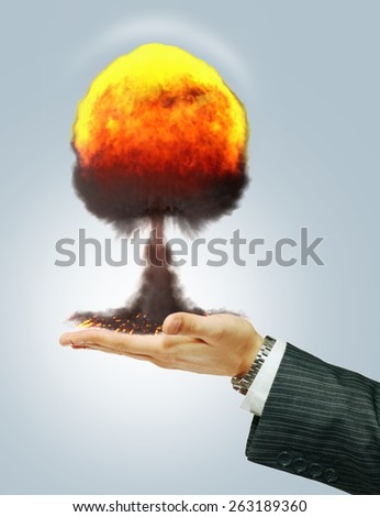 Nuclear explosion at hand politician - stock photo