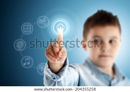 Nuclear physics. Boy pressing a virtual touch screen. Blue background. - stock photo