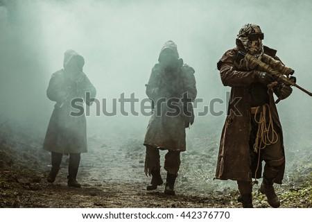 Nuclear post-apocalypse survivors - stock photo