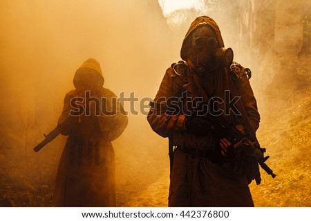 Nuclear post-apocalypse survivors - stock photo