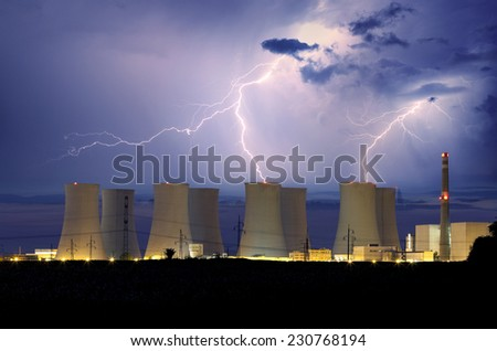 Nuclear power plant at storm - stock photo