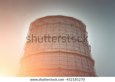Nuclear power plant at sunset - stock photo