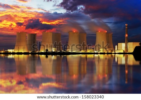 Nuclear power plant by night - stock photo