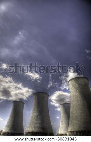 Nuclear power plant cooling tower - stock photo