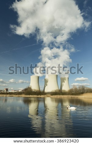 Nuclear power plant  Czech Republic reflected in the small lake.