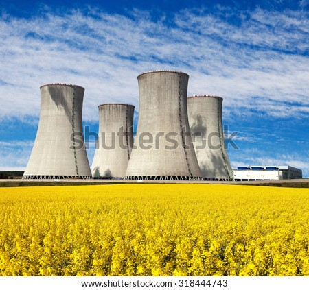 Nuclear power plant Dukovany with golden glowering field of rapeseed - Czech Republic - two possibility for production of energy