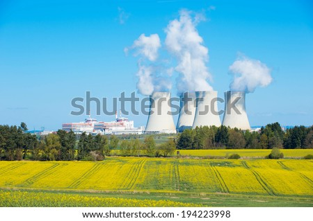Nuclear power plant in Czech republic. Image shows the large cooling towers and nature around. - stock photo