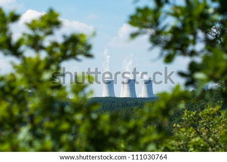 Nuclear power plant in summer landscape - stock photo
