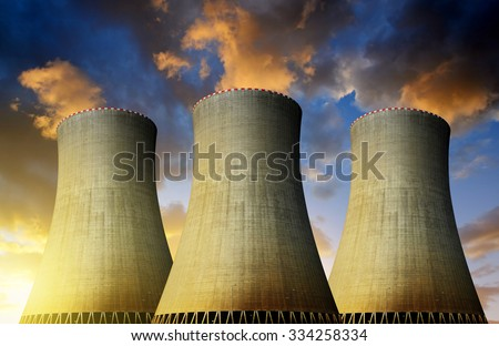 Nuclear power plant  in the sunset - stock photo