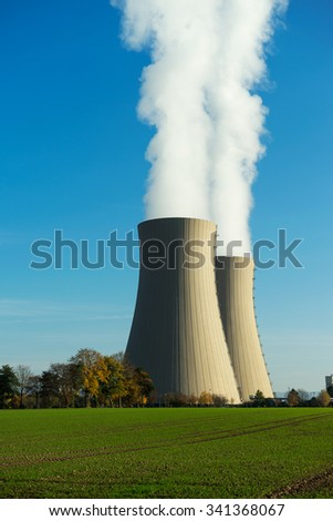 Nuclear power plant on the sky background in the sunlight
